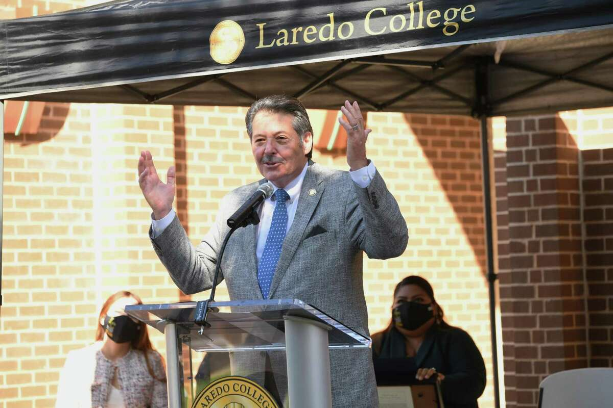 Laredo Mayor Pete Saenz yells out Viva Laredo after proclaiming the week of September 13, 2021 to be Laredo College Hispanic Serving Institution Week in front of the Harold Yeary Library on Tuesday.