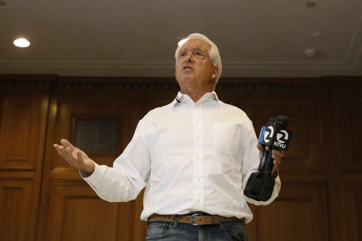 Republican recall candidate John Cox stands on a makeshift Monopoly board to represent high costs in California during a news conference at the Westin St. Francis in San Francisco on Aug. 10.