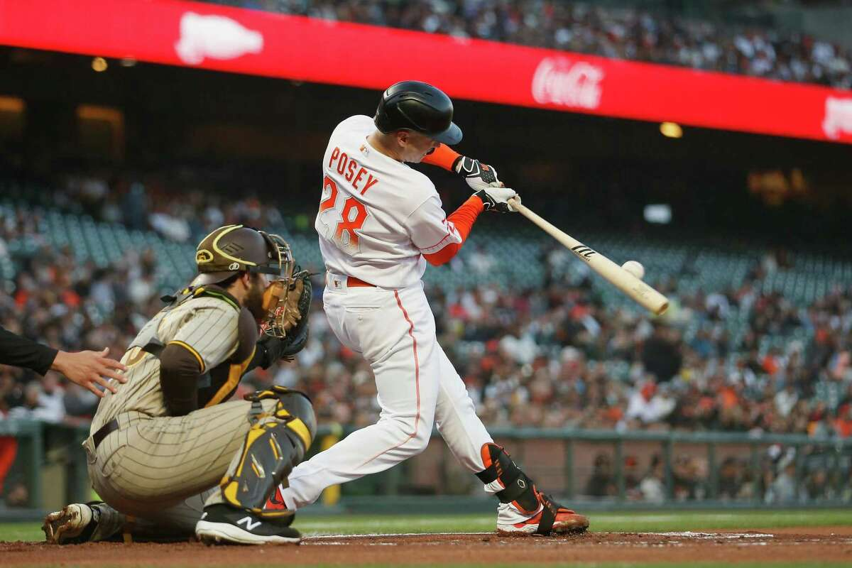 SAN FRANCISCO, CALIFORNIA - SEPTEMBER 14: Buster Posey #28 of the San Francisco Giants hits a solo home run in the bottom of the first inning against the San Diego Padres at Oracle Park on September 14, 2021 in San Francisco, California. (Photo by Lachlan Cunningham/Getty Images)
