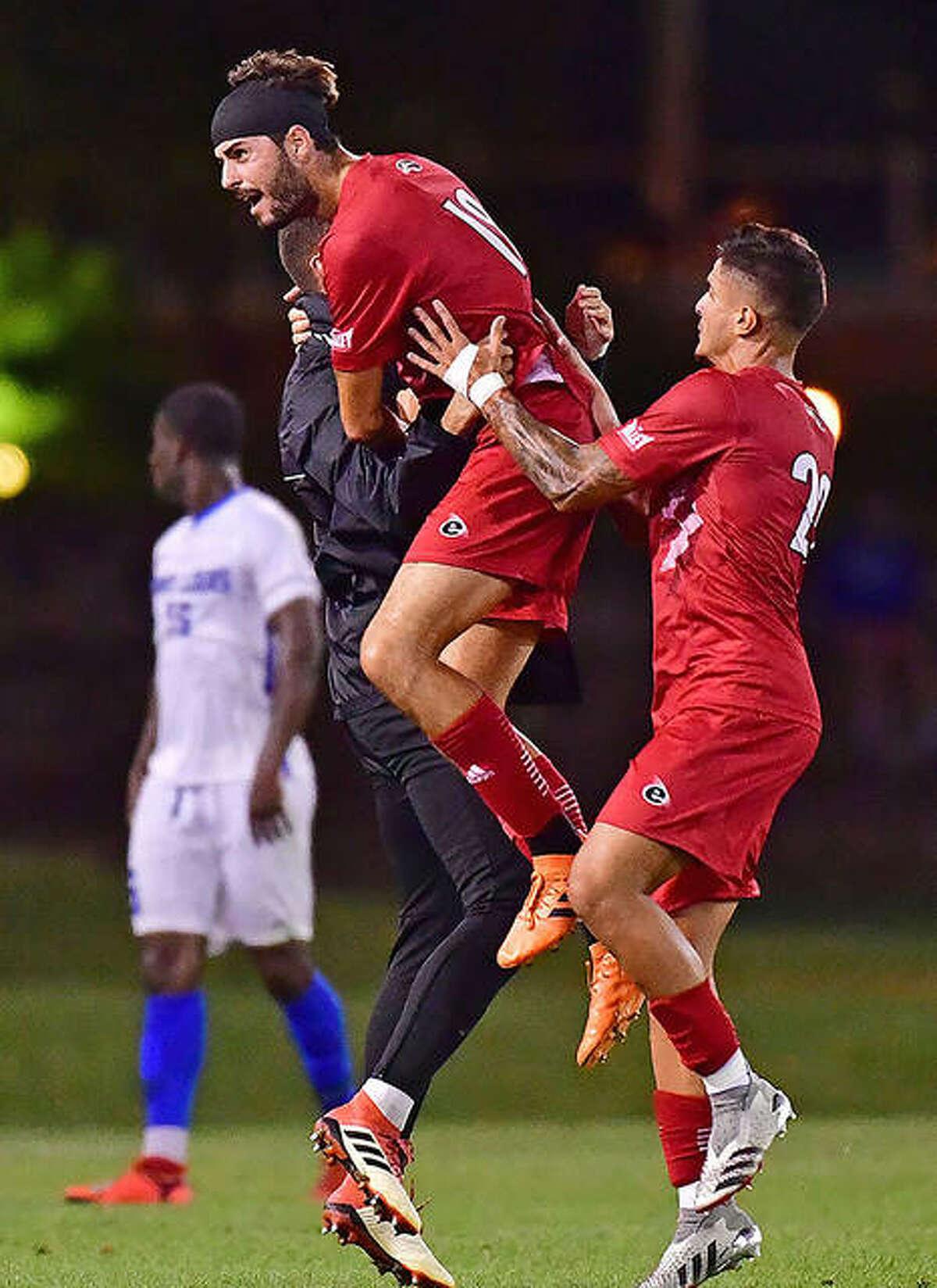 Paul Palacin, center, hugs an SIUE teammate after scoring late in Monday's Bronze Boot 1-1 tie with Saint Louis University at Hermann Stadium.
