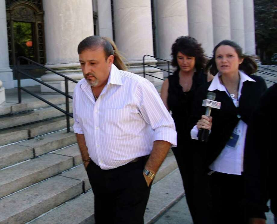 Shelton developer James Botti leaves U.S. Federal Court in New Haven, Conn., after he was sentenced to six years in prison and given a $25,000 fine on Friday September 17, 2010 and was ordered to report to prison on Nov. 29. He must also seek mental health treatment. Botti, 47, of Maple Avenue, Shelton, was convicted on charges of conspiring to structure and structuring cash transactions in amounts under $10,000 to avoid having them reported to the IRS during his first trial last November. In April, he was convicted of mail fraud. Photo: Mike Mayko / Connecticut Post