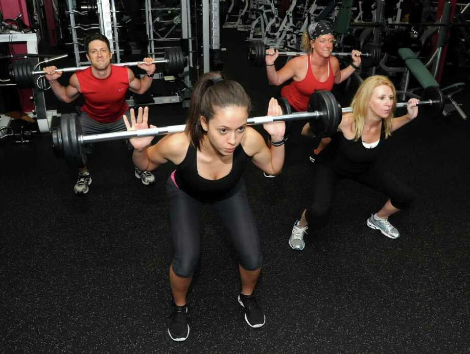 From left, Dan George, 36, of Danbury, Manuella Moreira, 22, of Danbury, Kimmie Rodrigues, 41, of Brookfield and Jodi Beardsley-Fioretini, 49, of Danbury, train for an urbanathlon that they will be participating in in Chicago on Oct. 16, 2010. pictured on Thurs. Sept. 16, 2010 at Sportsplex in Bethel. Photo: Lisa Weir / The News-Times Freelance