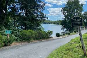 Candlewood Shore community beach in New Milford, Conn., where a Norwalk, Conn., father recently drowned in September 2021 after trying to help two children who were struggling while swimming.