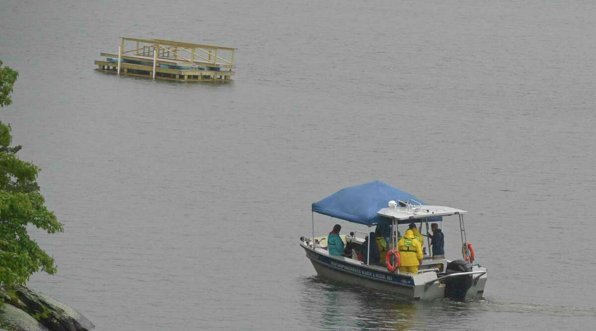 A file photo of first responders searching on Tuesday, May 28, 2019, for a missing teen last seen swimming in Candlewood Lake off Dike Point Park in New Milford, Conn.