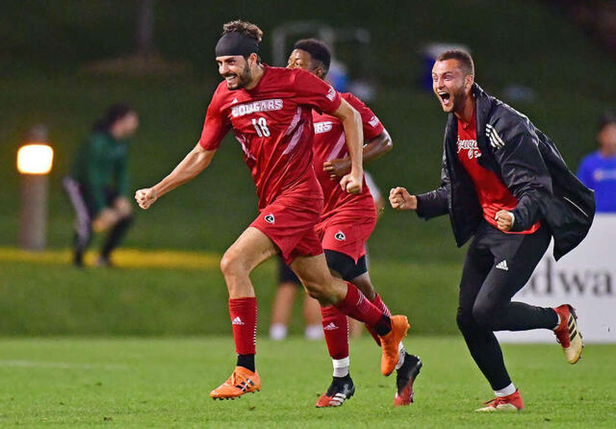 Pau Palacin (18) and his SIUE teammates celebrate after he scored the tying goal late in Tuesday night's Bronze Boot game against Saint Louis University at Hermann Stadium in St. Louis. The teams played to a 1-1 tie.