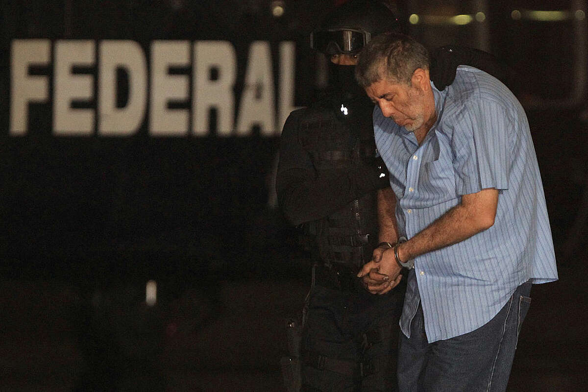 Vicente Carrillo Fuentes, alias El Viceroy, brother of the late Mexican drug lord Amado Carrillo, is escorted to a helicopter after his arrest at the hangar of the Attorney General of Mexico on October 09, 2014 in Mexico City.