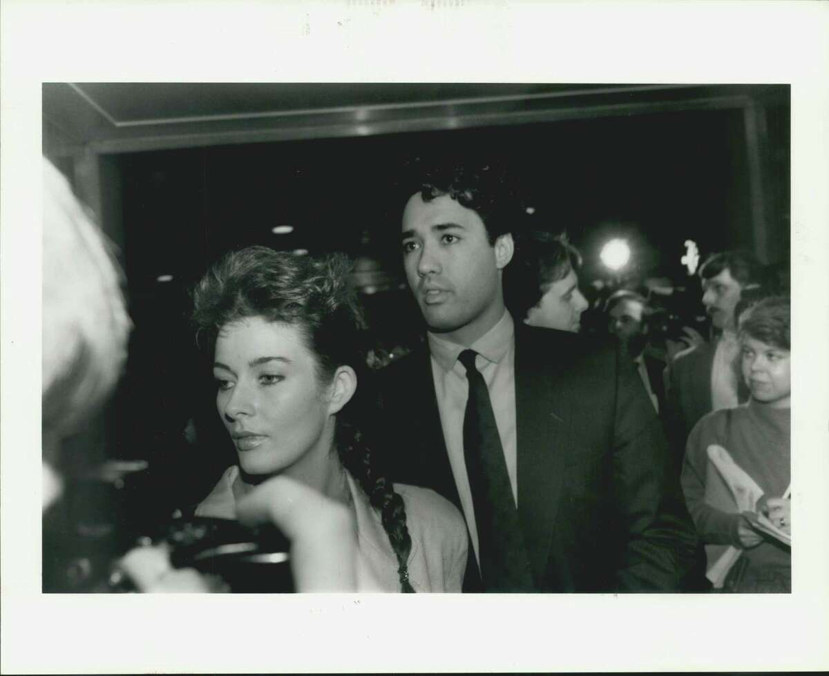 New York Mets pitcher Ron Darling leaves a Houston courtroom with his, Toni, wife after receiving a $200 fine and probation for his participation in an altercation outside Cooter's.
