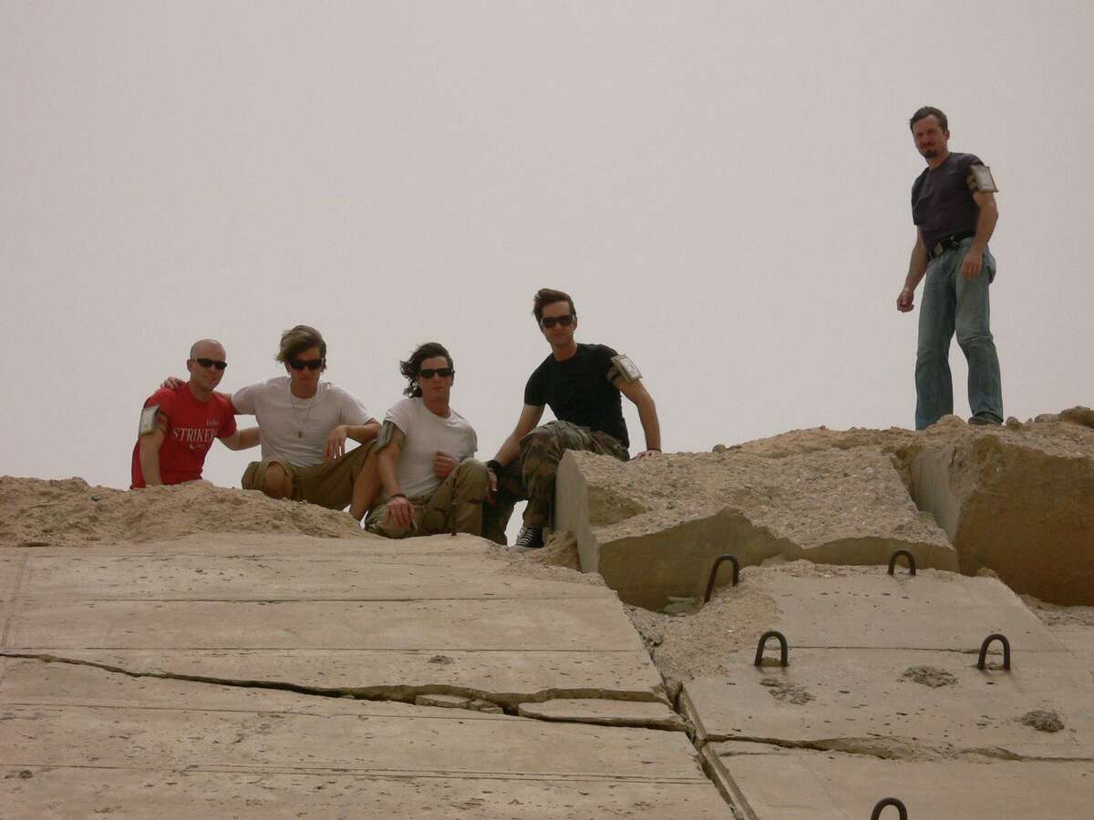 """Members of the band Edisun on top of blown out bunker in Iraq during one of their many concert tours in the Middle East. The band is the subject of a new documentary, """"Bulletproof Wings,"""" now streaming on Tubi."""