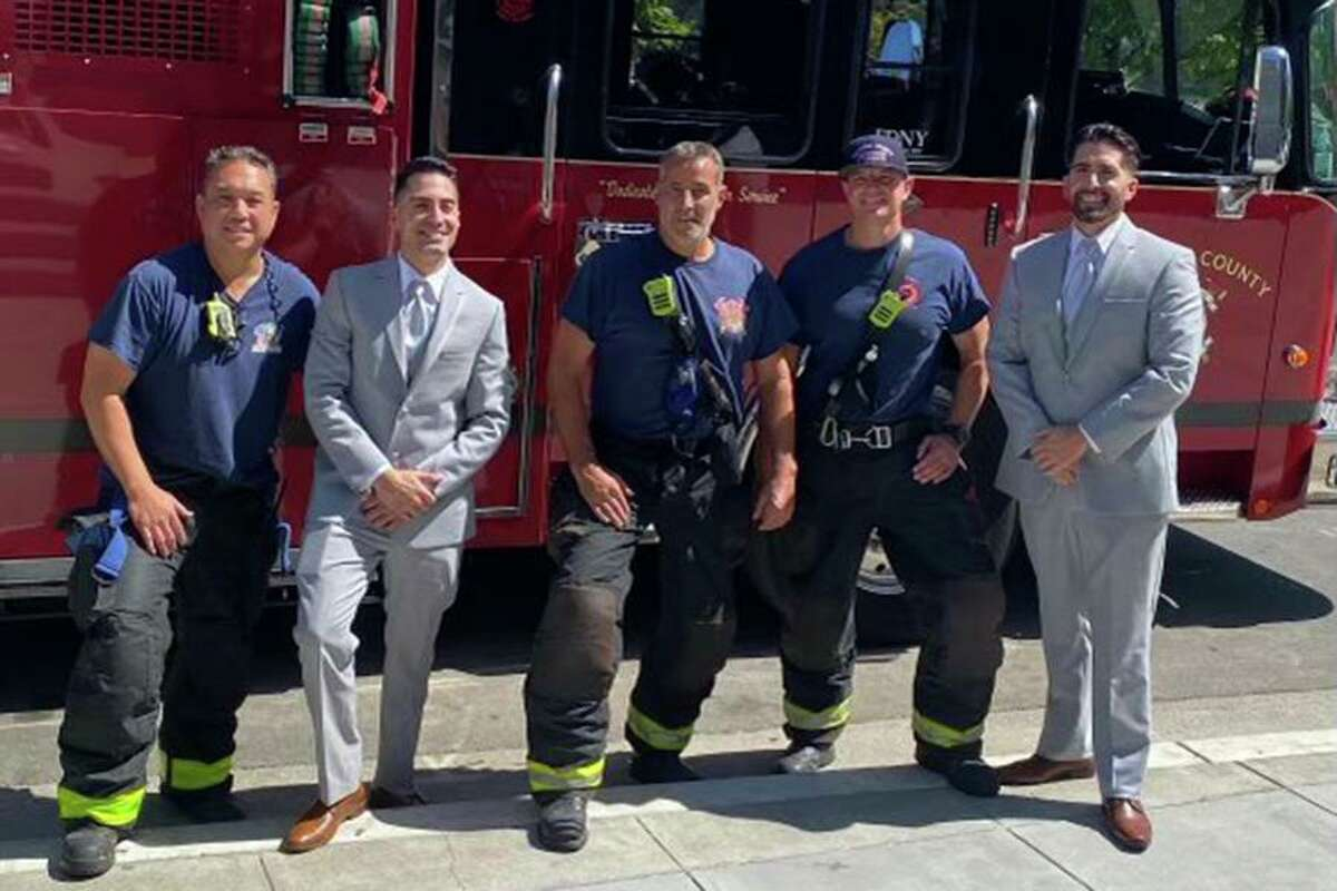 Alameda County firefighters on Saturday came to the aid of eight people trapped in an elevator in Emeryville, including a groom and groomsman on their way to a wedding.