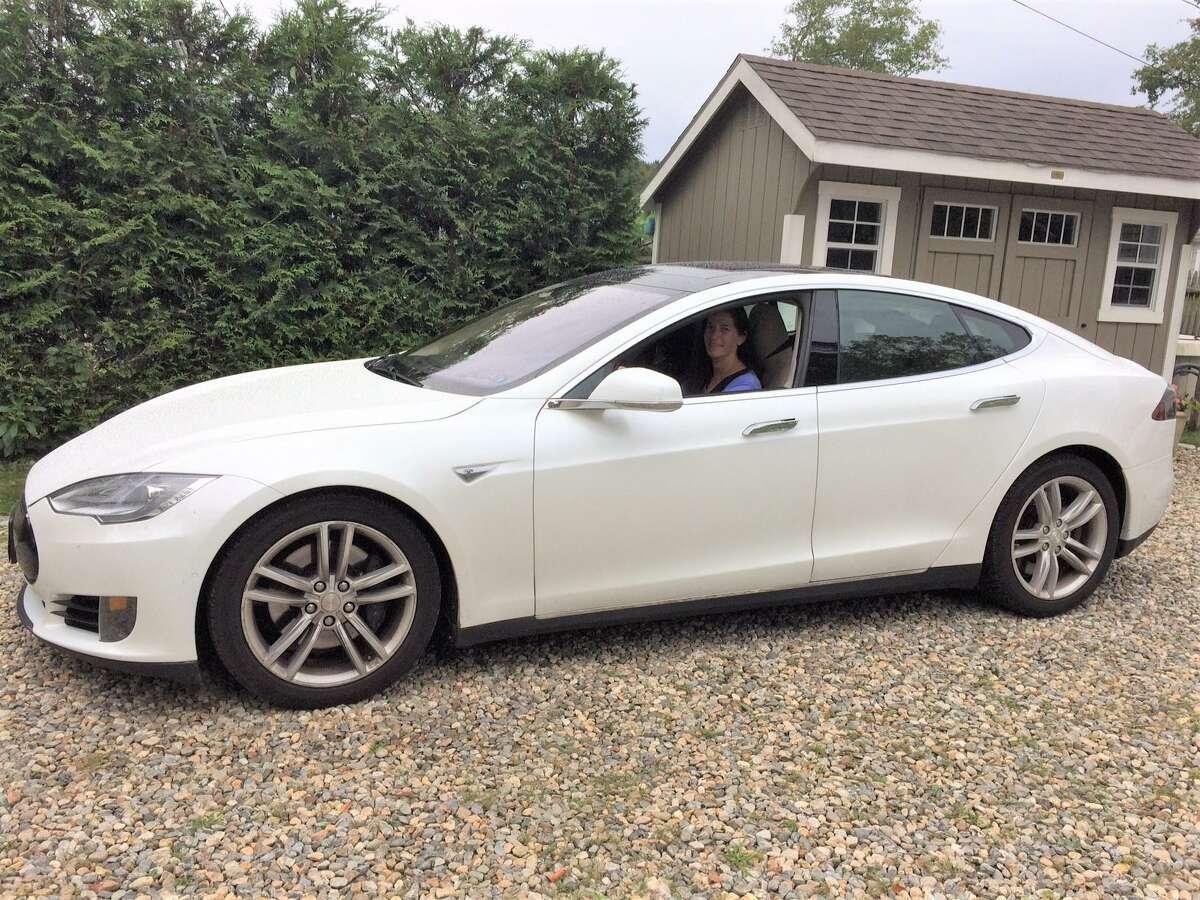 East Hampton resident Kristy Roloff in her 2015 Tesla S.