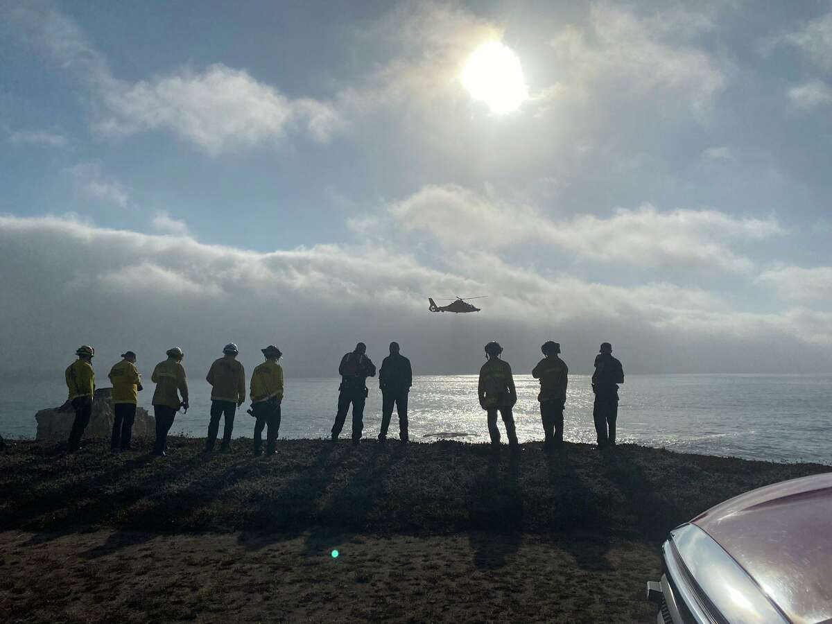 Rescuers respond Tuesday at Panther State Beach.