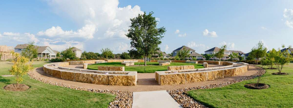 Residential lots nestled up to green spaces, playgrounds, exercise parks, butterfly gardens, a sports field, newly completed community garden and bocce ball court, and roughly 12 miles of hike and bike trails.