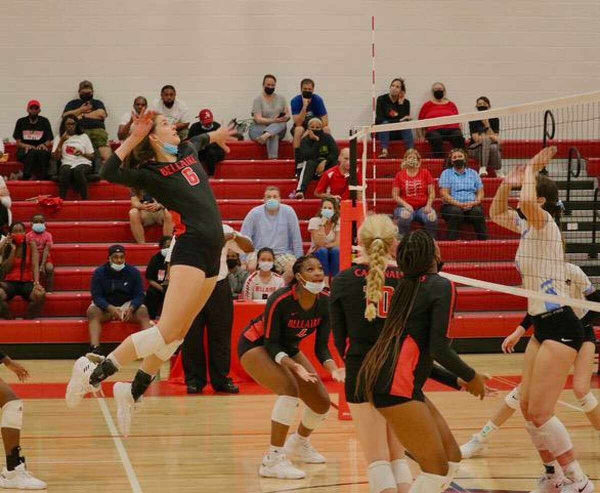 Bellaire outside hitter Eliza Konvicka goes up for a spike during the Lady Cardinal's match against Brazoswood on Aug. 31
