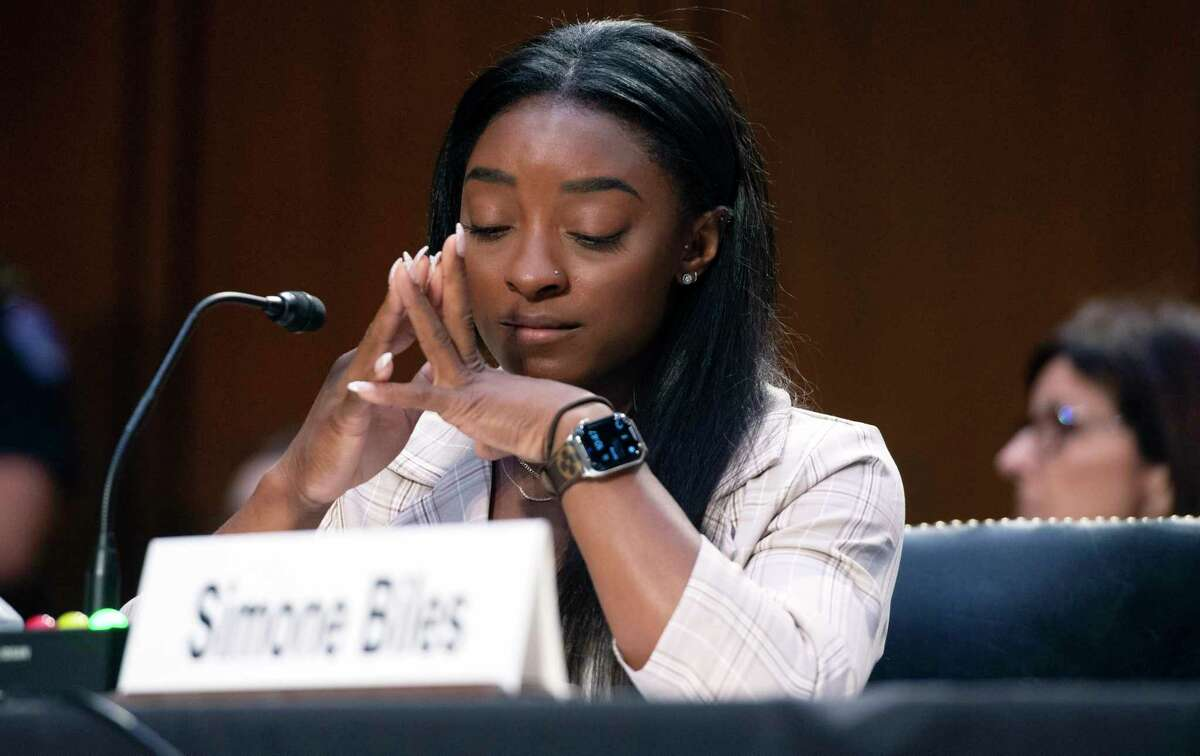 United States Olympic gymnast Simone Biles testifies during a Senate Judiciary hearing about the Inspector General's report on the FBI's handling of the Larry Nassar investigation on Capitol Hill, Wednesday, Sept. 15, 2021, in Washington. Nassar was charged in 2016 with federal child pornography offenses and sexual abuse charges in Michigan. He is now serving decades in prison after hundreds of girls and women said he sexually abused them under the guise of medical treatment when he worked for Michigan State and Indiana-based USA Gymnastics, which trains Olympians. (Saul Loeb/Pool via AP)