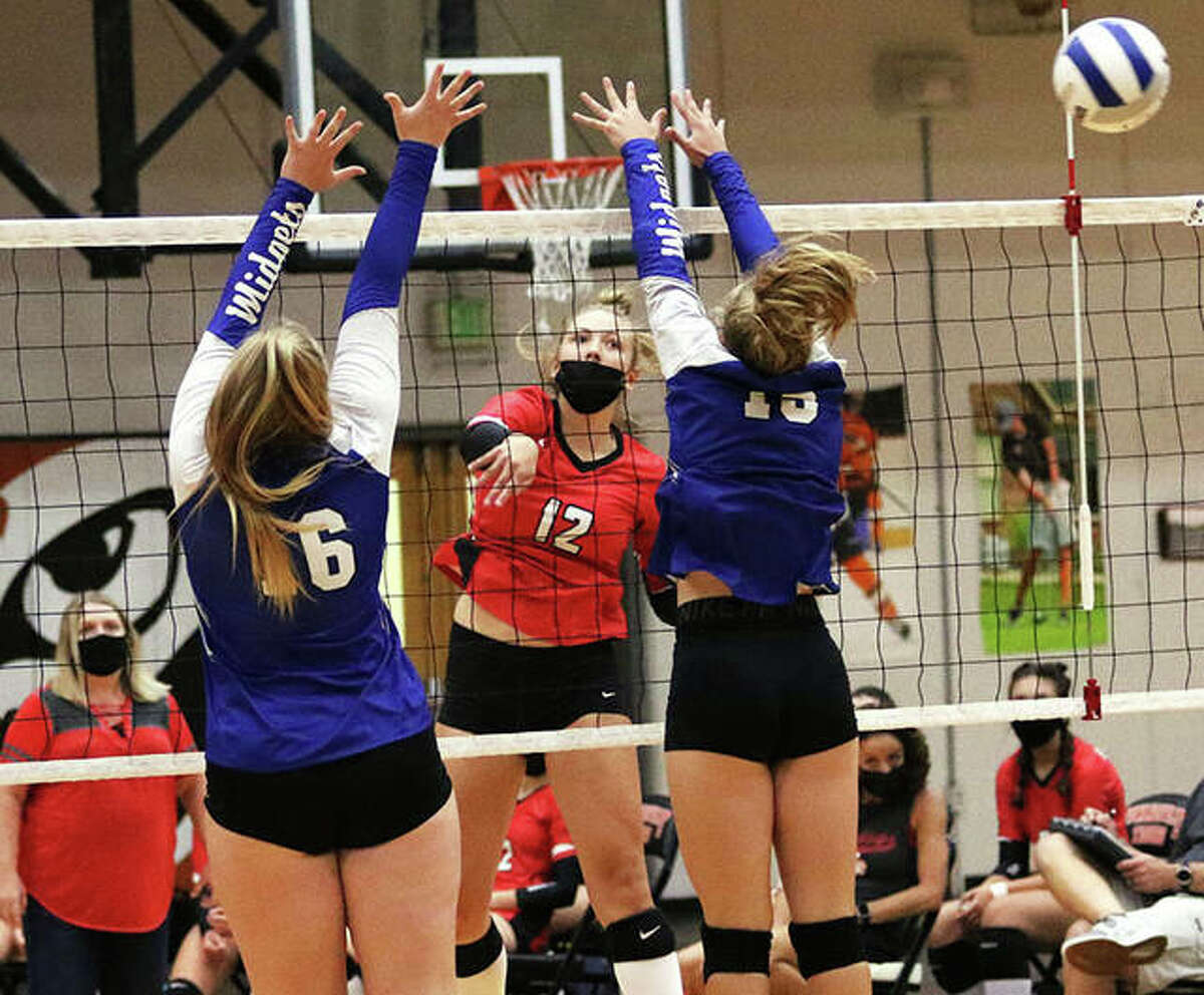 Staunton's Haris Legendre (middle) hits line for a kill past Freeburg's double block during a match Sept. 3 at the Tiger Classic in Edwardsville. On Tuesday, the Bulldogs saw their eight-match winning streak halted with a loss to Breese Mater Dei in Staunton.