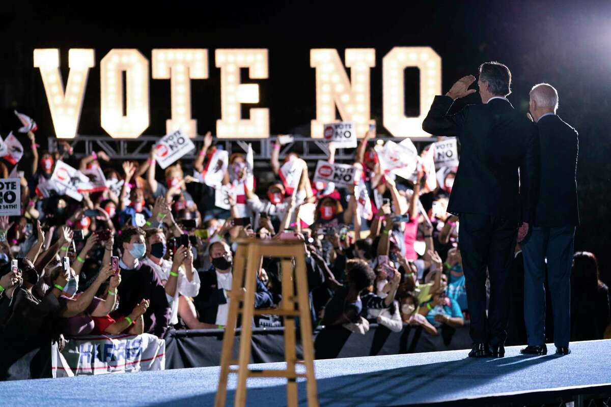 President Joe Biden stands with Gov. Gavin Newsom, D-Calif., during a get out the vote rally at at Long Beach City College, Monday, Sept. 13, 2021, in Long Beach, Calif.