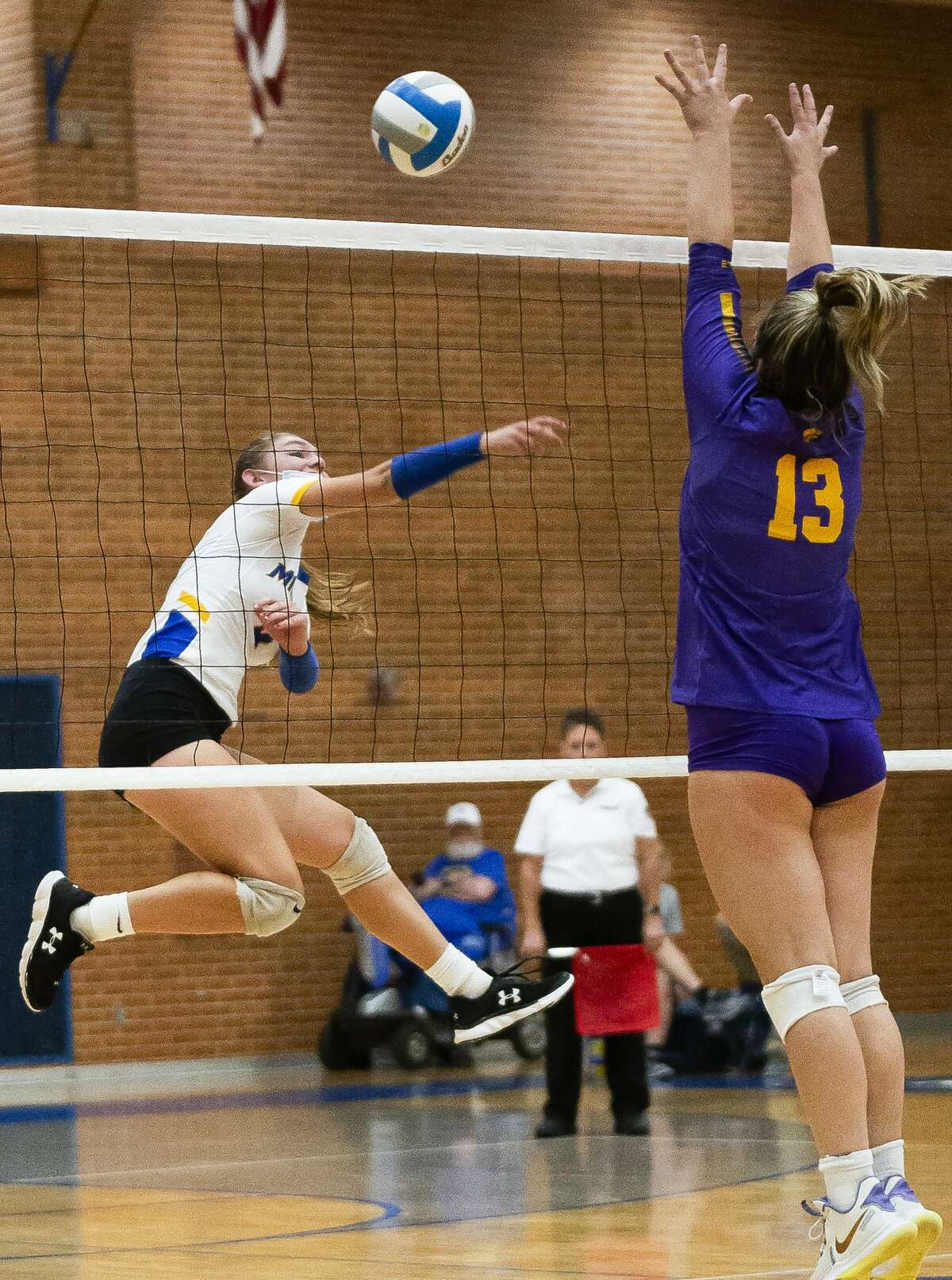 Midland's Renee Mulvaney spikes the ball during the Chemics' match against Bay City Central Tuesday, Sept. 14, 2021 at Midland High School. (Doug Julian/for the Daily News)