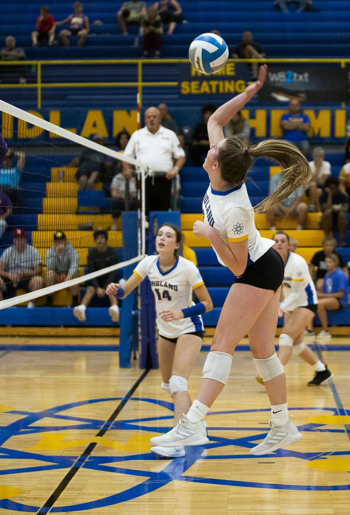 Midland's Emily Genau spikes the ball during the Chemics' match against Bay City Central Tuesday, Sept. 14, 2021 at Midland High School. (Doug Julian/for the Daily News)