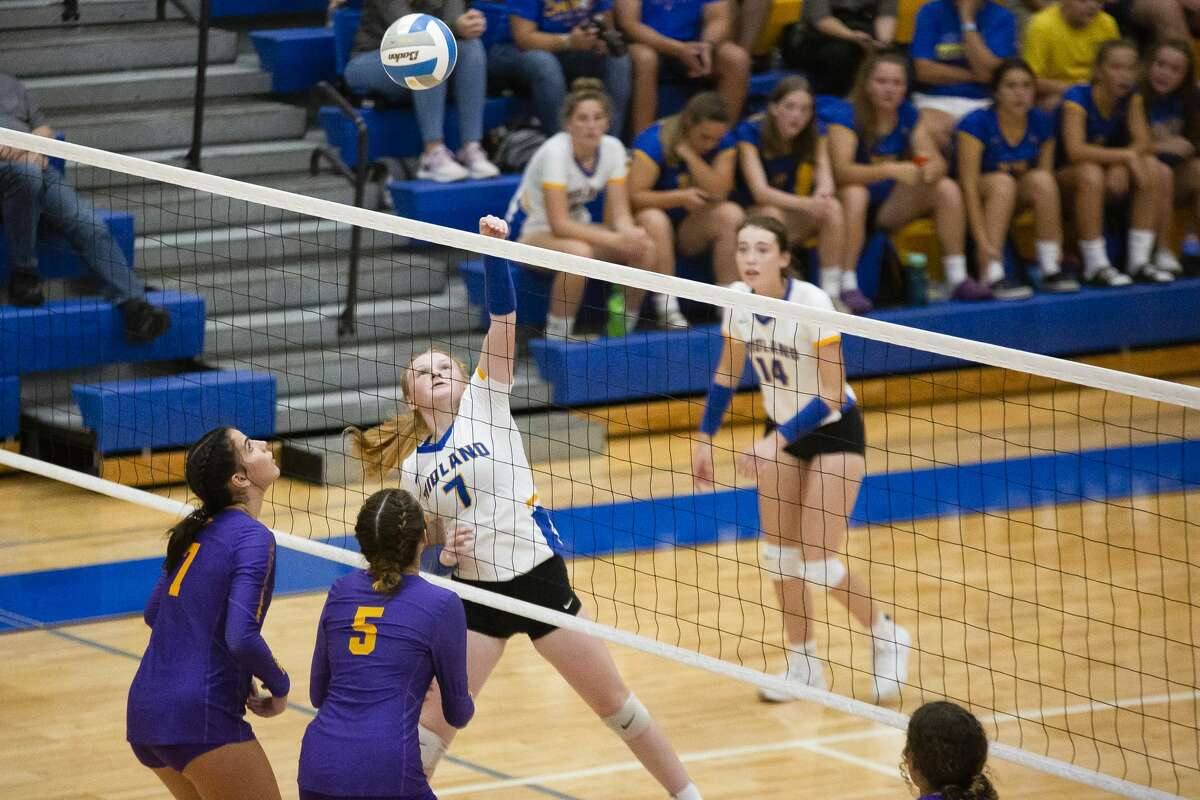Midland's Hayden Purvis spikes the ball during the Chemics' match against Bay City Central Tuesday, Sept. 14, 2021 at Midland High School. (Doug Julian/for the Daily News)