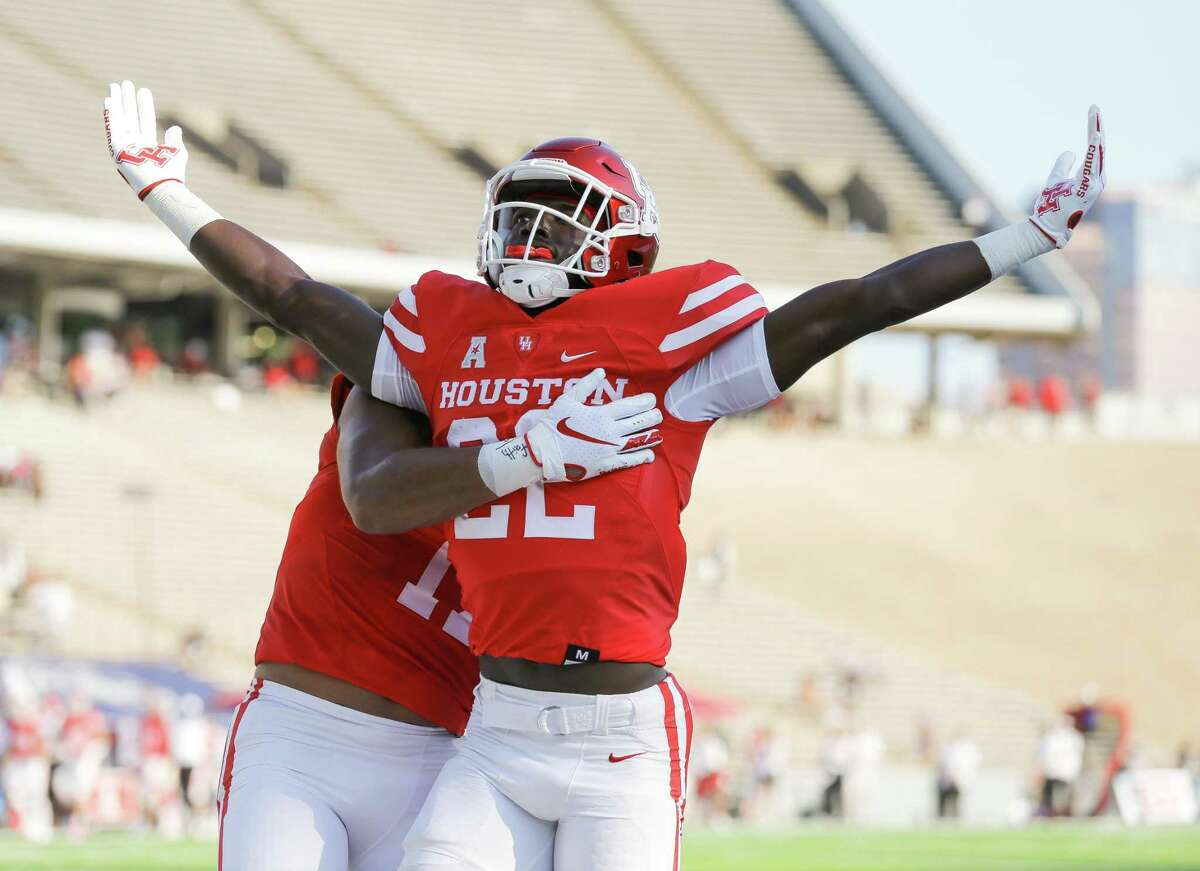 Houston Cougars running back Alton McCaskill (22) celebrates after scoring a 35-yard receiving touchdown against the Rice Owls during the first quarter of an NCAA game at Rice Stadium on Saturday, Sept. 11, 2021, in Houston.
