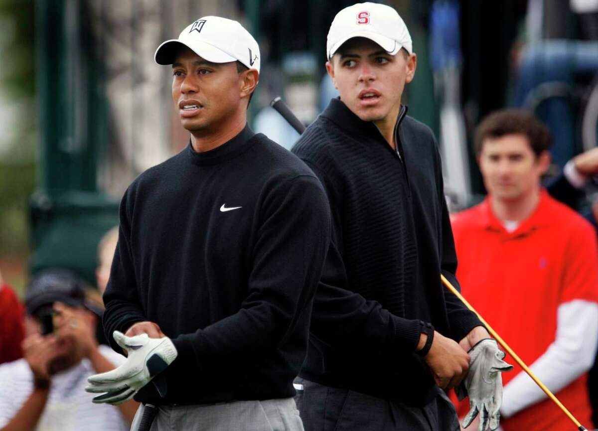 Joseph Bramlett (right) plays a practice round with fellow Stanford alum Tiger Woods before the 2010 U.S. Open at Pebble Beach. Bramlett qualified to play in the event at age 22.