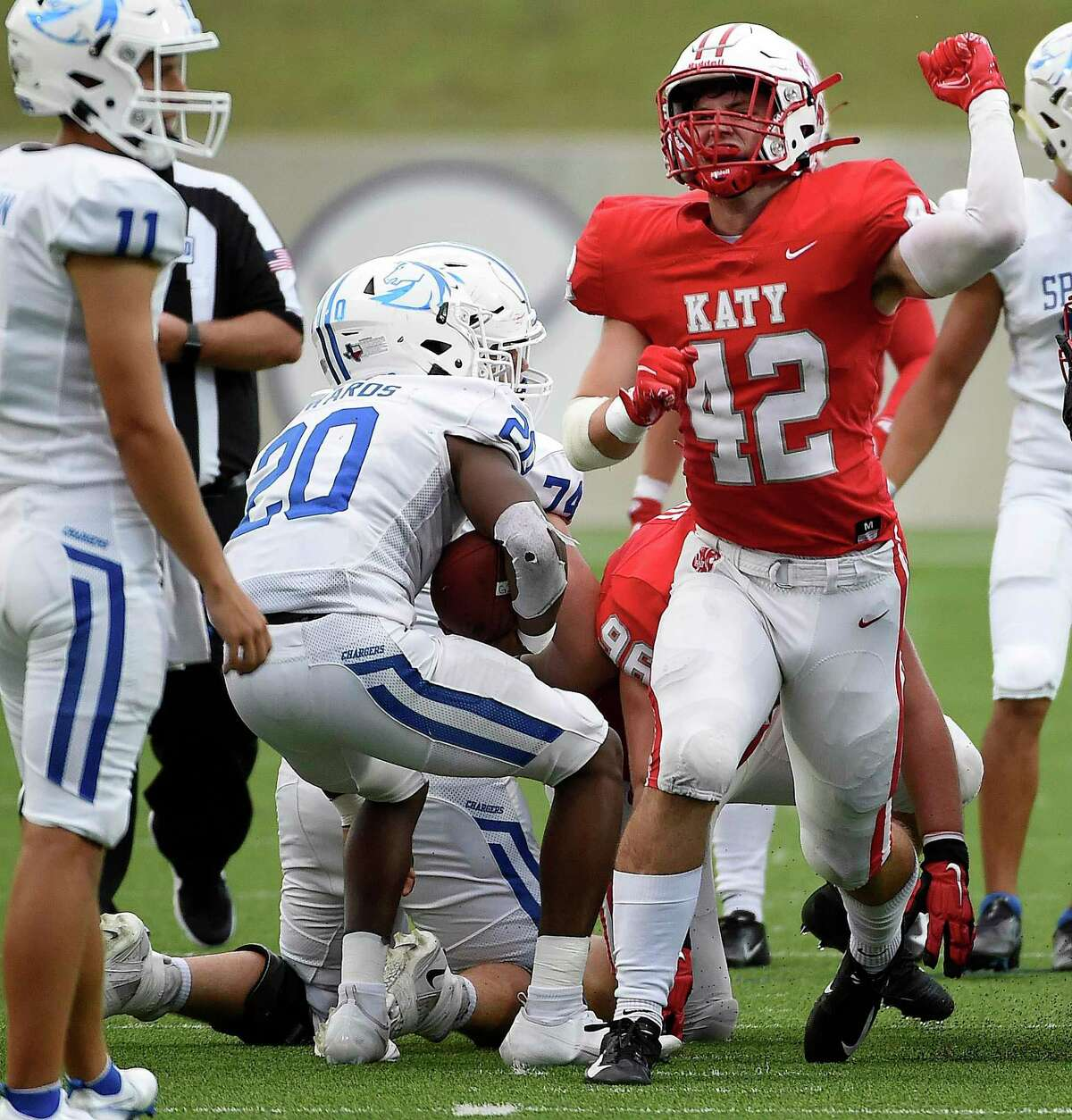 Katy linebacker Ty Kana (42) celebrates his tackle of Clear Springs running back Xai-Shaun Edwards (20) during the first half of a high school football game, Friday, Aug. 27, 2021, in Katy.