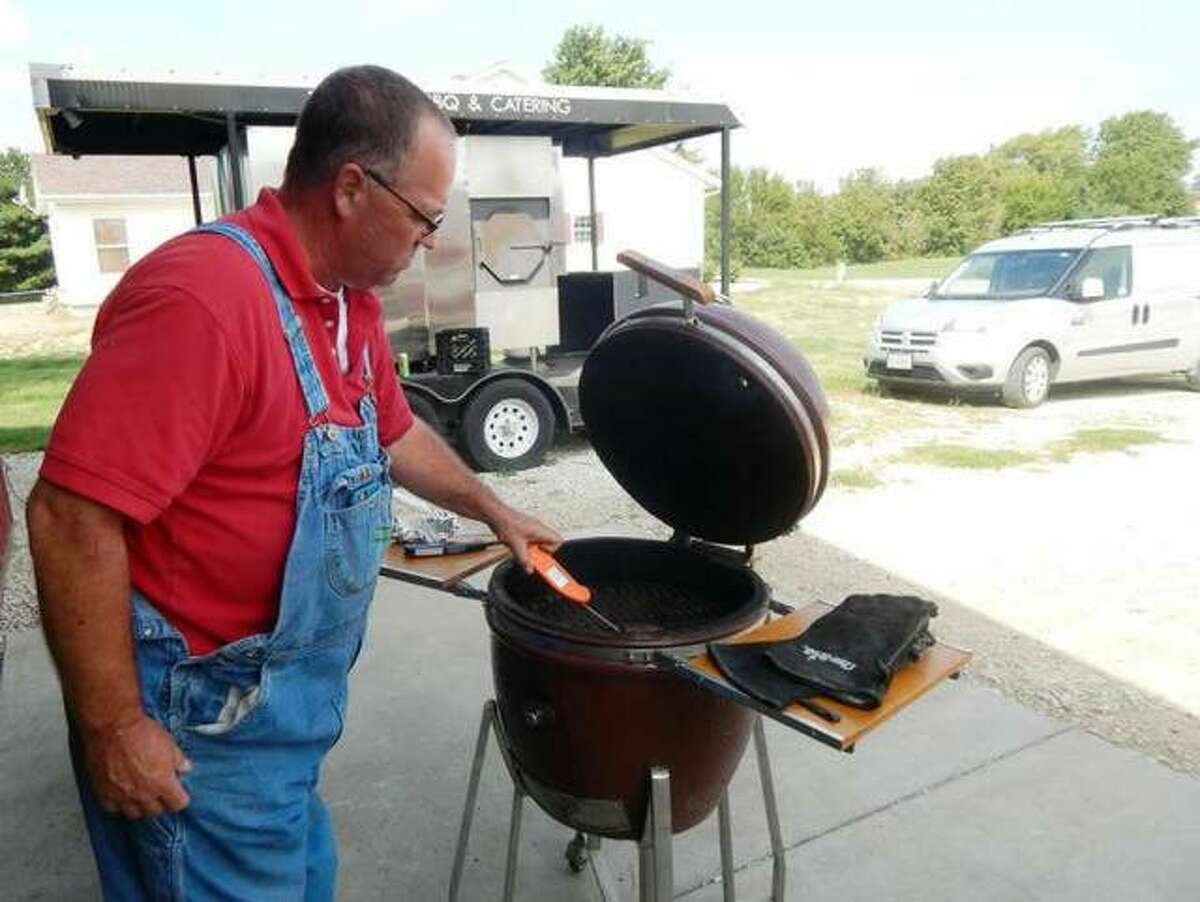 Randy Twyford of Twyford BBQ & Catering uses a digital thermometer in 2017 to check the temperature of a sirloin steak he's grilling.