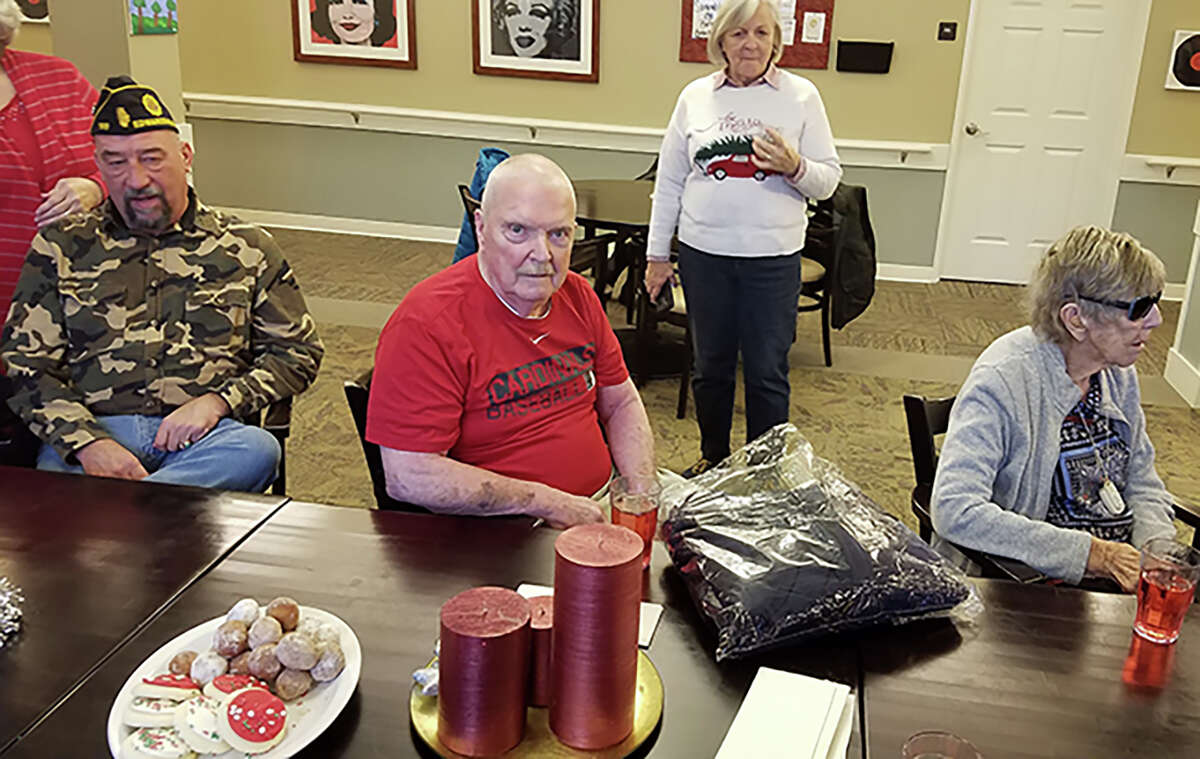 """A veteran at a local nursing home with his gift package in 2018, when Edwardsville American Legion Post 199 provided Christmas gifts to veterans through the """"Gifts to the Yanks Who Gave"""" program."""