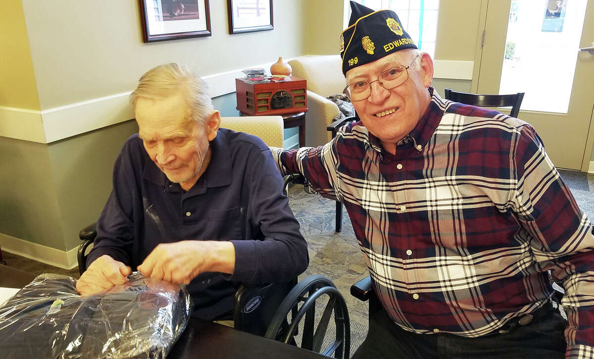 """Ron Swaim, right, who is now the commander of Edwardsville American Legion Post 199, with a veteran at a local nursing home in 2018, when Post 199 provided gifts to veterans through the """"Gifts to the Yanks Who Gave"""" program."""
