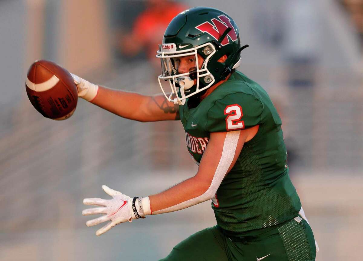 The Woodlands wide receiver Parker McGill (2) scores on a 27-yard pass from quarterback Mabrey Mettauer during the first quarter of a non-district high school football game at Woodforest Bank Stadium, Friday, Sept. 10, 2021, in Shenandoah.