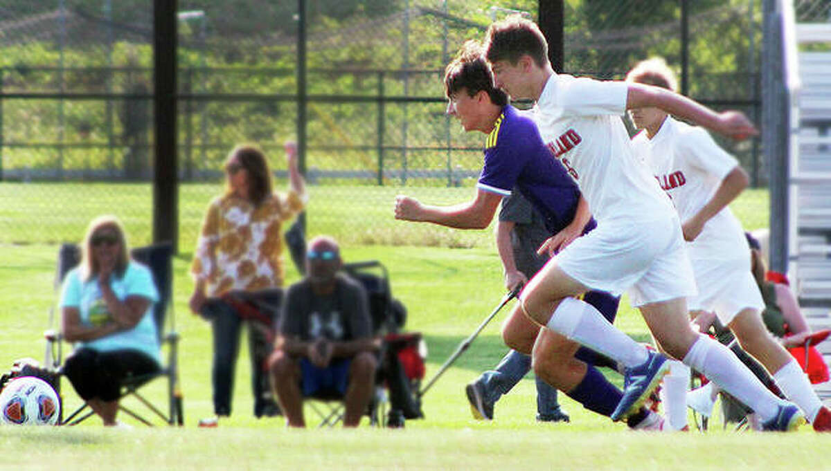 Brayden Zyung of CM, left, scored a pair of goals in his team's 7-2 Mississippi Valley Conference victory at Jersey. The Eagles remained undefeated at 9-0. Zyung is shown playing in a recent game against Highland.