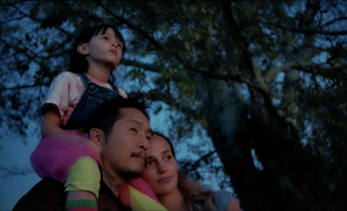 """From left: Sydney Kowalske, Justin Chon and Alicia Vikander in """"Blue Bayou."""""""