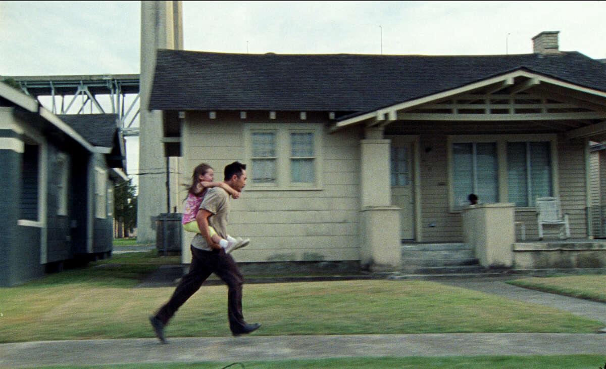"Sydney Kowalske, left, and Justin Chon in ""Blue Bayou."""