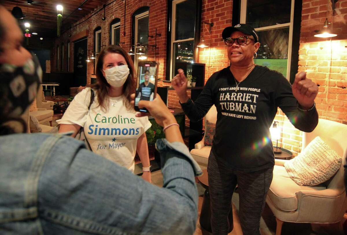 Jere Eaton, right, a supporter of Democratic mayoral candidate Caroline Simmons, congratulates her on camera for winning her primary election during a party for her at campaign headquarters at Third Place by Half Full Brewery on Pacific Street in Stamford on Tuesday.