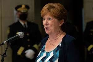 Albany Mayor Kathy Sheehan speaks as she and Albany Police Chief Eric Hawkins take part in the promotion of 12 Albany police officers in a ceremony at Albany City Hall on Wednesday, Sept. 15, 2021 in Albany, N.Y.