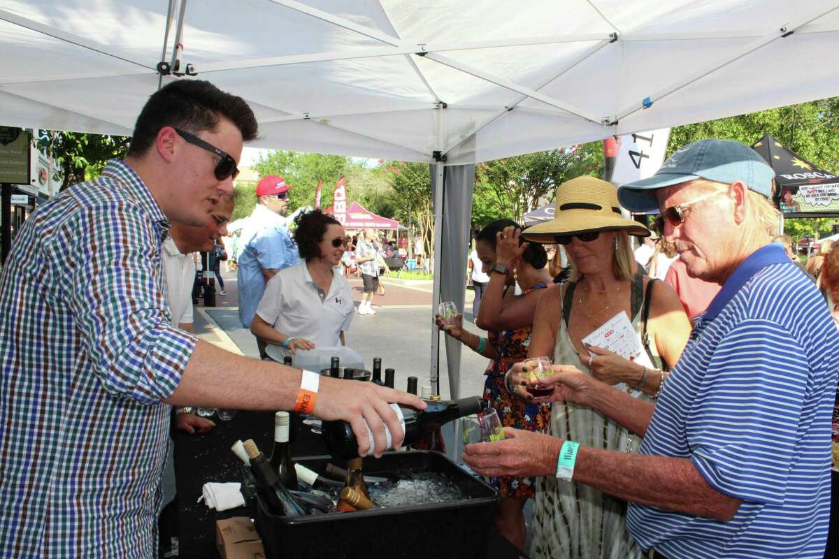Ryan Partridge, with Jackson Family Wines, discusses the various wines his company offers while pouring a Cabernet Sauvignon for one of the many guests at the H-E-B Wine Walk at Market Street on Thursday, June 7, 2018. This year's Wine Walk is set for Oct. 21.