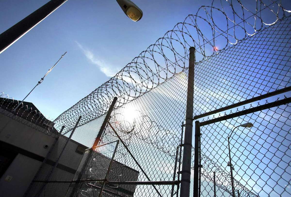 In this Jan. 5, 2012 photo, razor wire tops the fencing at the Polunsky Unit prison in Livingston, Texas. ( Bob Owen/Houston Chronicle )