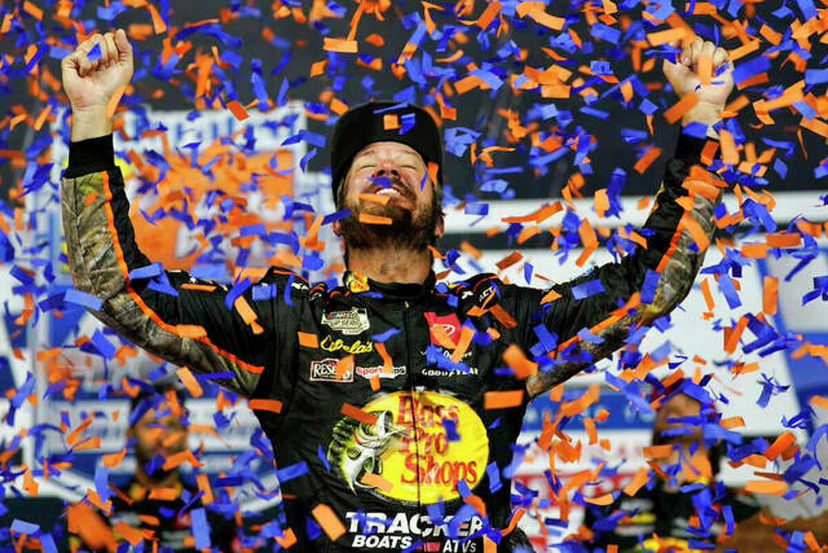 Martin Truex Jr., celebrates winning the NASCAR Cup series auto race in Richmond, Va., Saturday, Sept. 11, 2021.