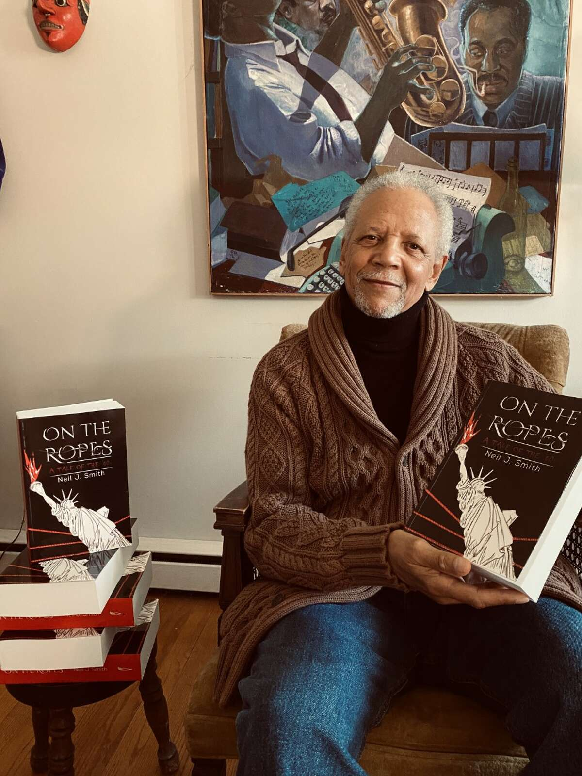 """Author Neil J. Smith with his novel, """"On the Ropes: A Tale of the '60s."""""""