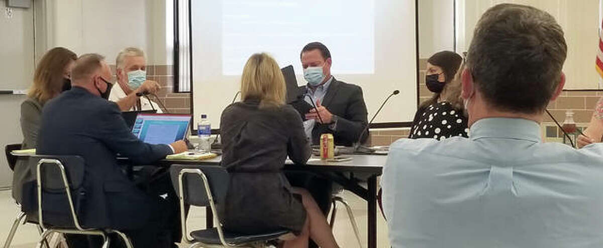 The Edwardsville School District 7 Board of Education discusses middle school devices during a newly reoccurring workshop Monday.