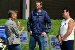 Challenger Jenn McMurrer, right, campaigns with Tyler Fairbairn in front of Marvin Elementary School Tuesday, September 14, 2021, as voters cast their ballots for the Common Council seat for District C in the primary election in Norwalk, Conn.