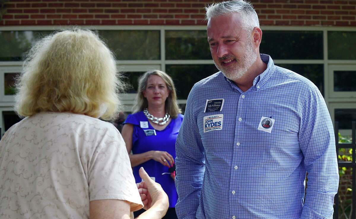 Incumbent John Kydes campaigns outside Nathan Hale Middle School Tuesday, September 14, 2021, in Norwalk, Conn. Kydes faces challenger Jenn McMurrer in the Common Council seat primary in District C.