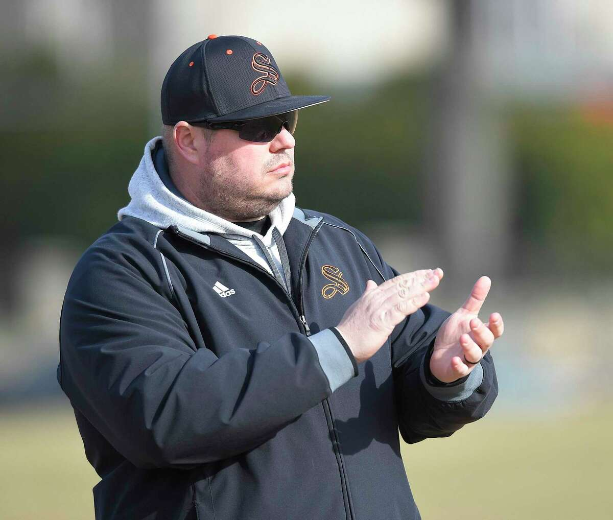 Stamford High School baseball coach Rit Lacomis applauds the action of his players in the first inning of a scrimmage baseball game against Greenwich, Thursday, March 28, 2019 in Stamford, Connecticut.