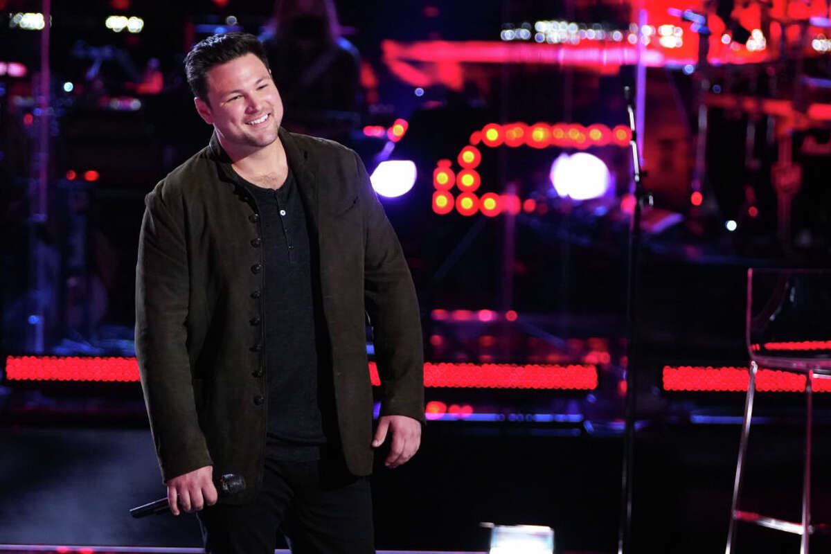 """Ian Flanigan from Saugerties is shown competing in a knockout round on season 19 of NBC's """"The Voice"""" in 2020. The singer finished third in the televised network competition that season."""