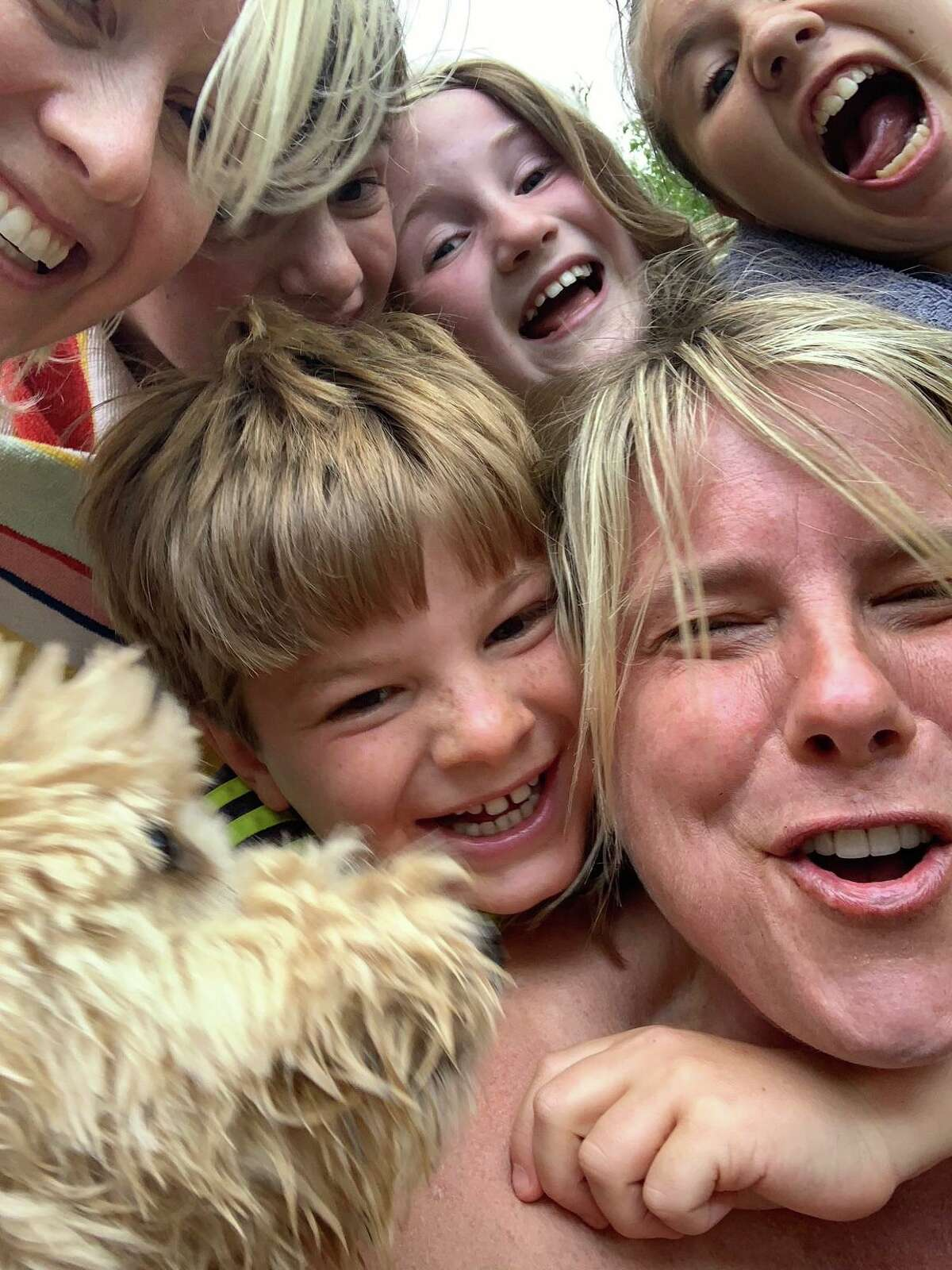 Claire Tisne Haft, on right, who writes the Mother Lode column, and some of the many children from her vacation in the Adriondacks last month.