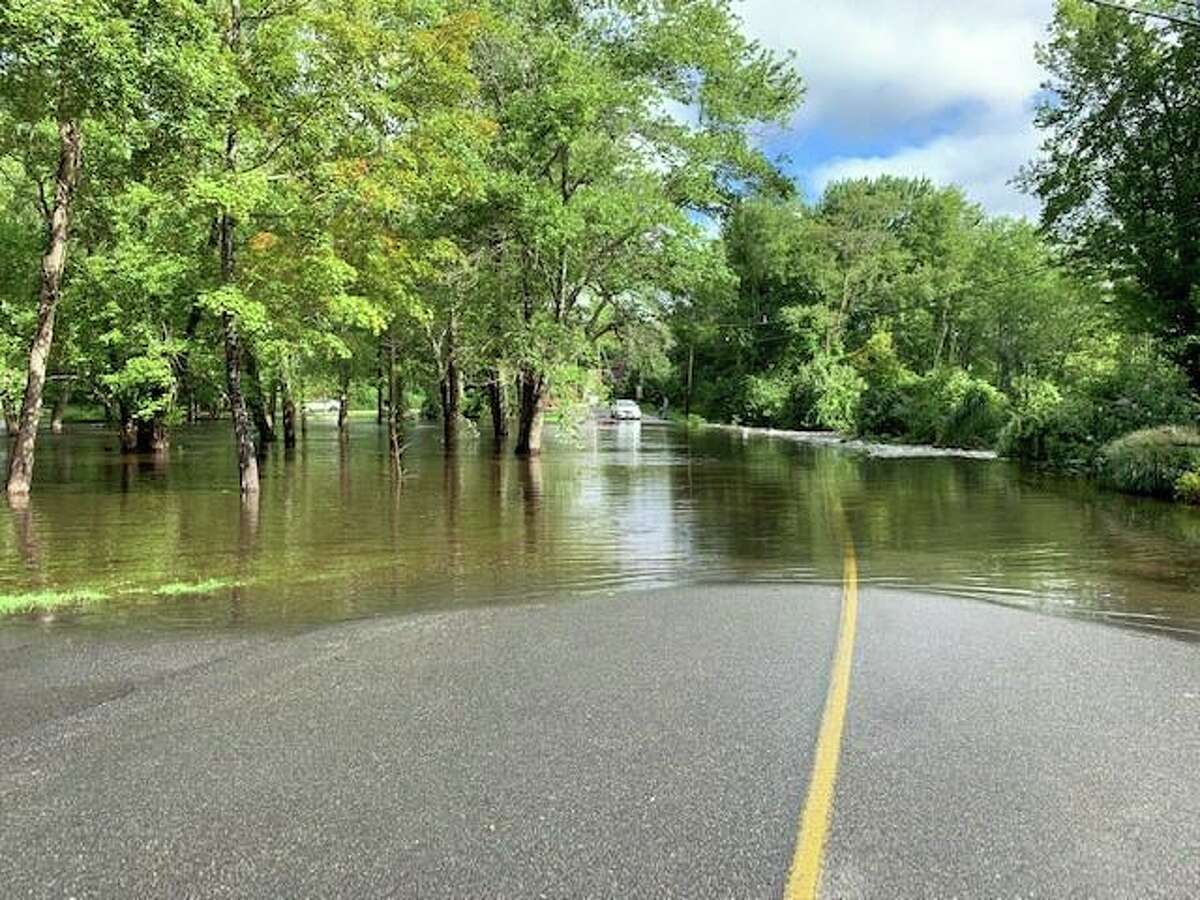 The Falls River in Essex flooded some 75 feet onto Falls River Drive following storm Ida, making it impassable.