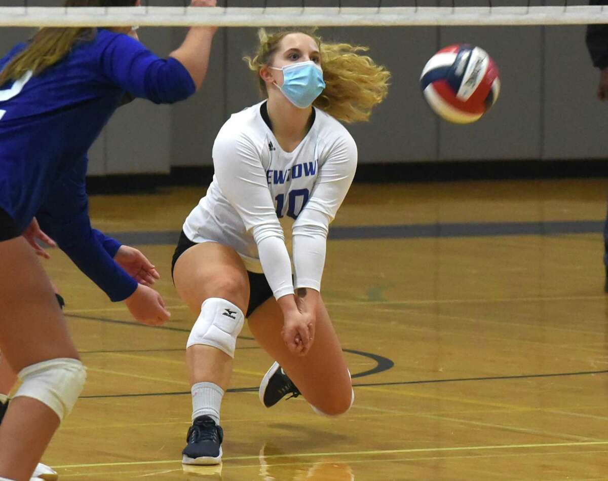 Newtown's Chloe O'Connell (10) keeps the ball alive during a match at Darien on Monday.
