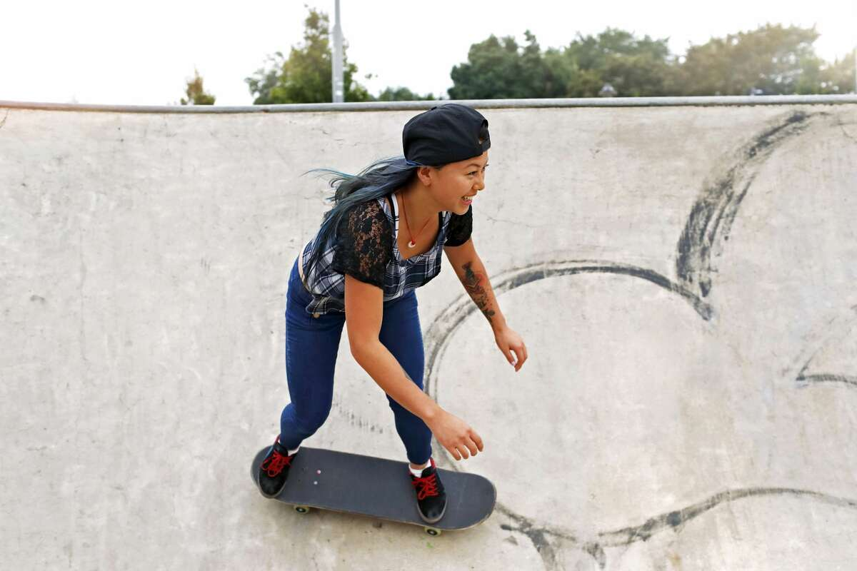 A young woman riding a skateboard