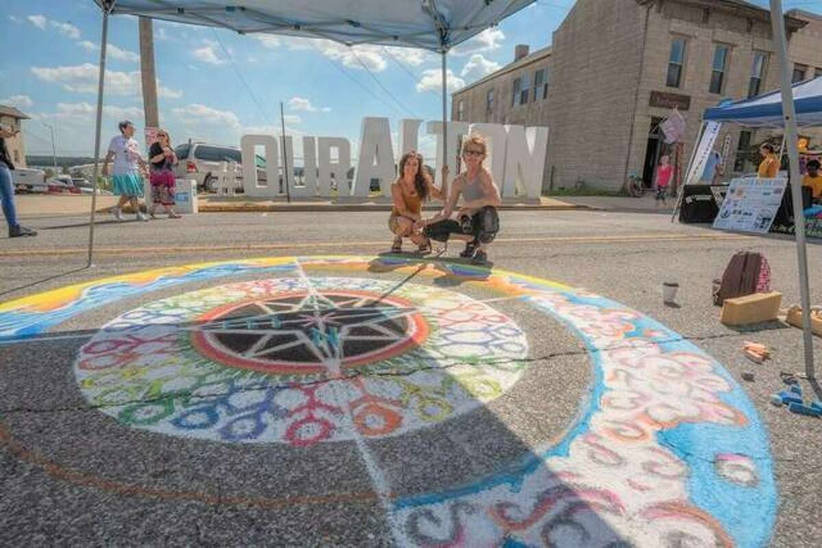A large colorful mandala adorns East Broadway in Alton at a past Mississippi Earthtones Festival. Chalk artists will return this year to decorate the street with large colorful mandalas this Saturday during the 15th annual Mississippi Earthtones Festival from noon to 10 p.m.
