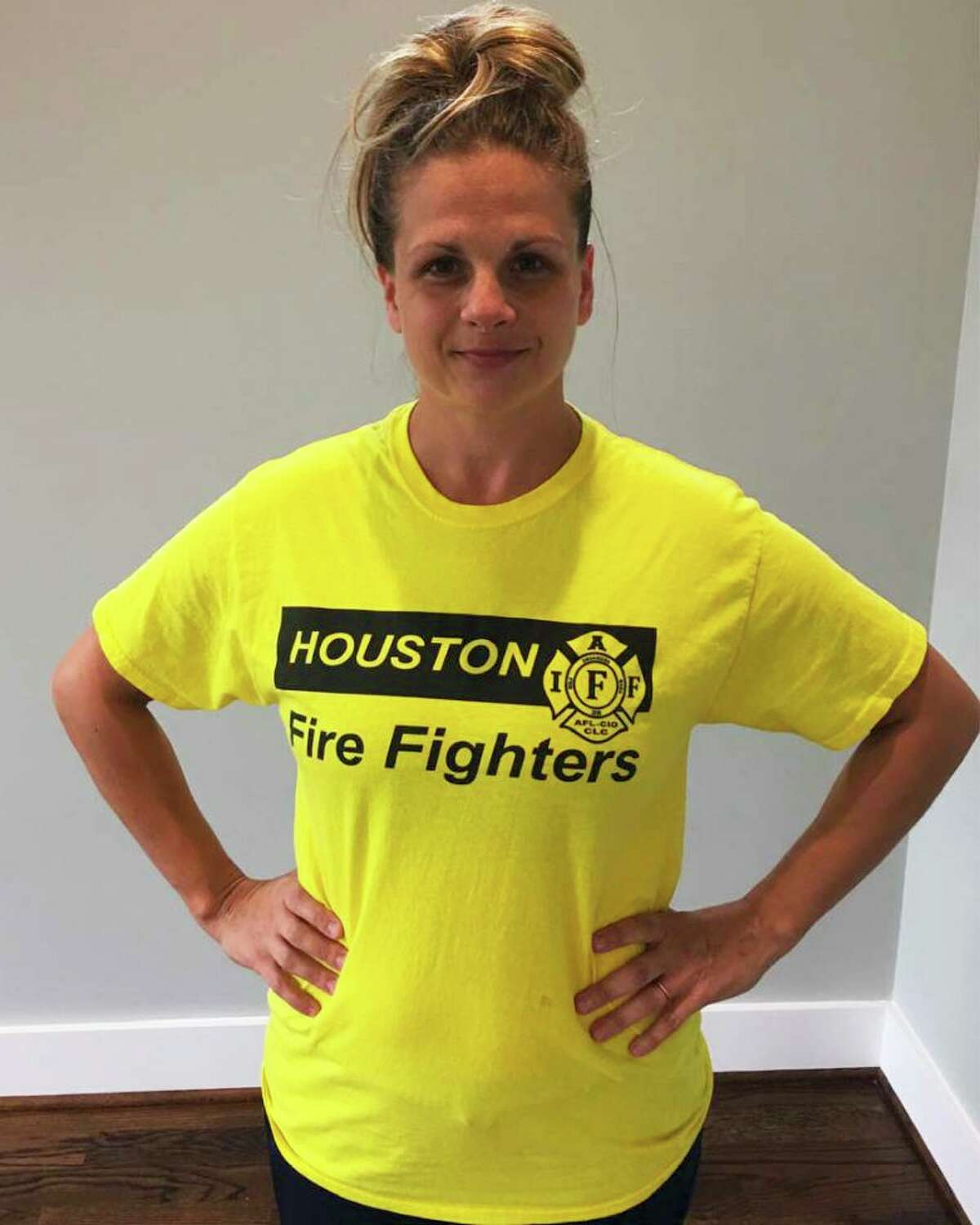 Jillian Ostrewich, who is married to a Houston firefighter, is pictured wearing the T-shirt she wore to a Harris County polling place for early voting in October 2018, when a pay parity measure for firefighters was on the ballot. According to court documents, election officials told her she could not cast her vote with the logo showing, so she turned her T-shirt inside out and was able to proceed. Credit: Pacific Legal Foundation.